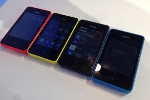 Nokia Asha 501 neljänä eri värivaihtoehtona. Punainen, keltainen, musta ja sininen kuvassa. Kuvasta puuttuvat kirkkaanvihreä sekä valkoinen värivaihtoehto.