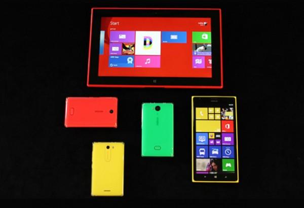Nokian tänäisiä uutuuksia: kuvassa Lumia 2520 -tabletti, kuuden tuuman Lumia 1520 sekä Asha-trio. Kuvasta puuttuu myös uutuuksiin lukeutunut Lumia 1320.