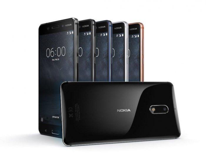 Nokia 6. Etualalla kiiltävä musta Arte Black -versio, joka tulee eri hintaan ja vasta myöhemmin.