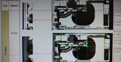 Kuvassa suurena mustana möykkynä näkyy iPhonen sisäinen kela, jota hyödynnetään langattomassa latauksessa.
