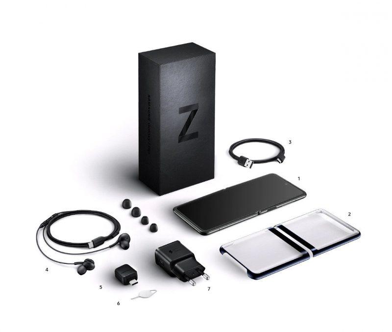 Samsung Galaxy Z Flipin myyntipakkauksen sisältö. 1. Puhelin 2. Clear Cover -suojakuori 3. Kaapeli 4. AKG-kuulokkeet USB-C-liittimellä 5. USB-USB-C-sovitin 6. SIM-korttineula 7. Laturi.