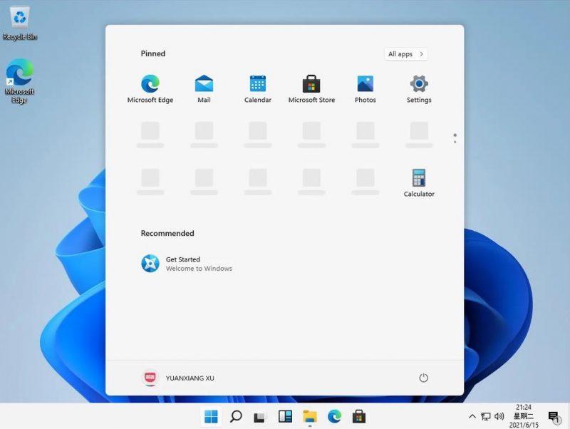 Windows 11 tuo käyttöliittymämuutoksia, kuten uuden aloitusvalikon ja oletuksena keskelle sijoitetut kuvakkeet tehtäväpalkissa.